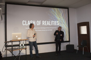 """Björn Bartholdy and Gundolf S. Freyermuth welcome the crowd  to the """"Main Conference Day"""""""